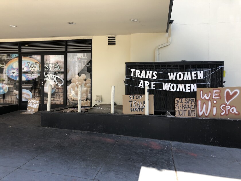 """One of the signs outside of Wi Spa in Koreatown on Saturday says: """"Trans women are women."""""""
