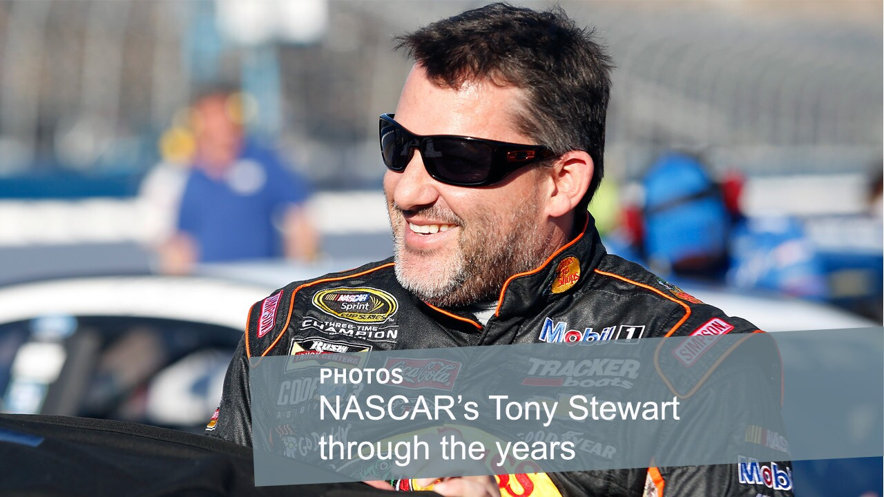 NASCAR Sprint Cup driver Tony Stewart smiles during qualifying at Phoenix International Raceway on March 13, 2015.