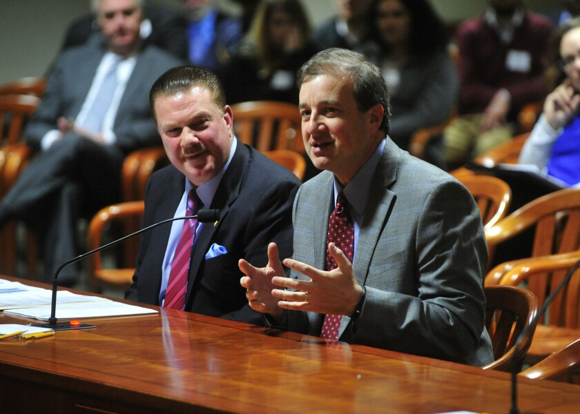 Scott Yates, right, testifies before the Michigan State Legislature in 2017 alongside Republican State Sen. Peter Lucido on the perils of daylight saving time.