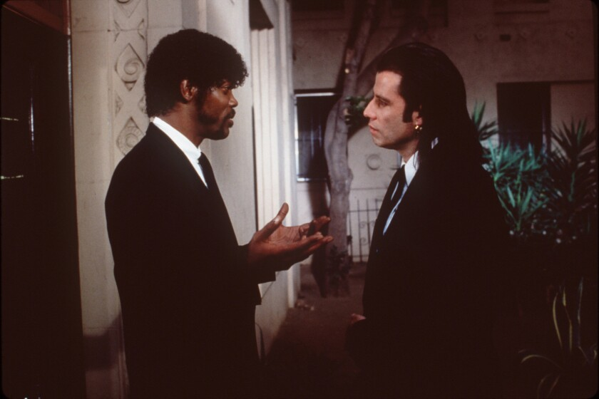 "John Travolta, right, and Sam Jackson in a scene from the movie ""Pulp Fiction."""