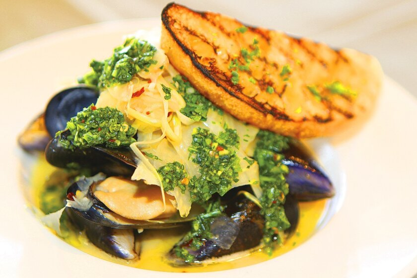 A light-and-flavorful starter are Steamed Carlsbad Black Mussels with fennel, leek and Italian salsa verde at The Shores restaurant in La Jolla. Photo by Daniel K. Lew