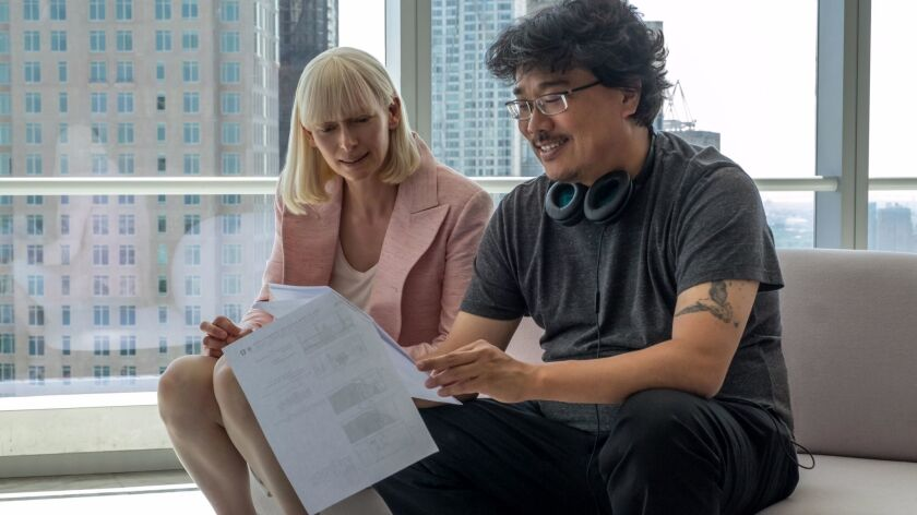 "Tilda Swinton and director Bong Joon Ho on the set of ""Okja""."