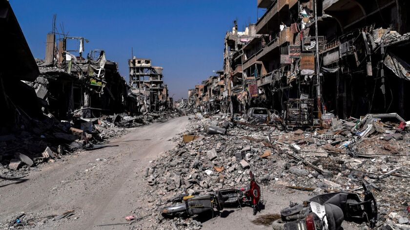 Heavily damaged buildings in Raqqa after a Kurdish-led force expelled Islamic State fighters from the northern Syrian city.