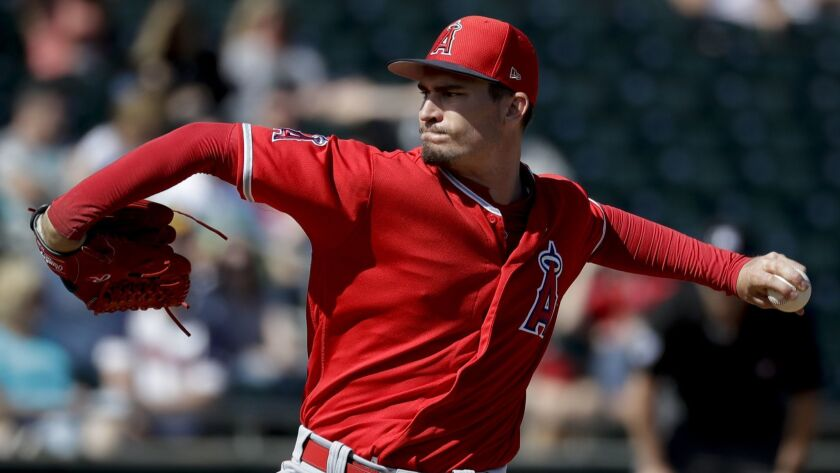 Angels starting pitcher Andrew Heaney throws against the Oakland Athletics during the first inning of a spring game in Mesa, Ariz. on Feb. 26.