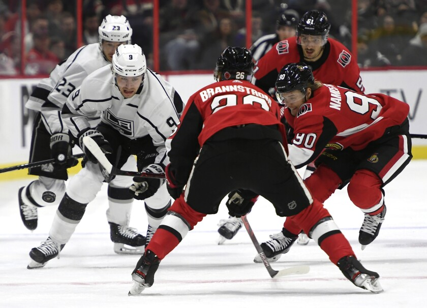 Kings left wing Adrian Kempe (9) makes his way down the ice as Senators defenseman Erik Brannstrom (26) and center Vladislav Namestnikov (90) defend during the first period of a game Nov. 7.