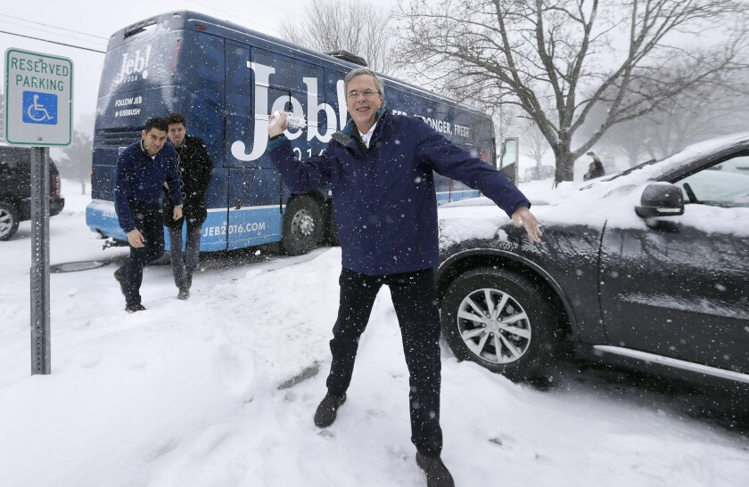 Republican presidential candidate former Gov. Jeb Bush of Florida throws a snowball in February 2016 in Nashua, N.H.