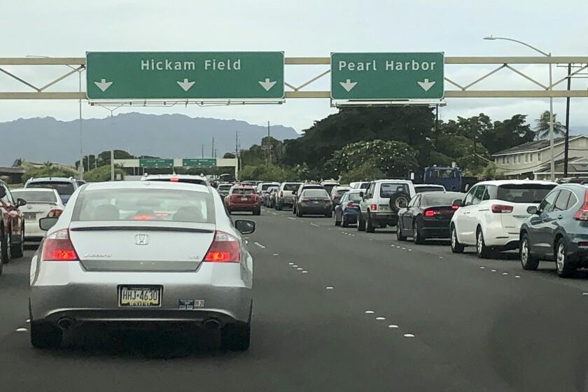 Traffic backs up at the main gates after a shooting at Pearl Harbor Naval shipyard, Wednesday, Dec. 4, 2019, near Pearl Harbor in Honolulu. (AP Photo/Caleb Jones)