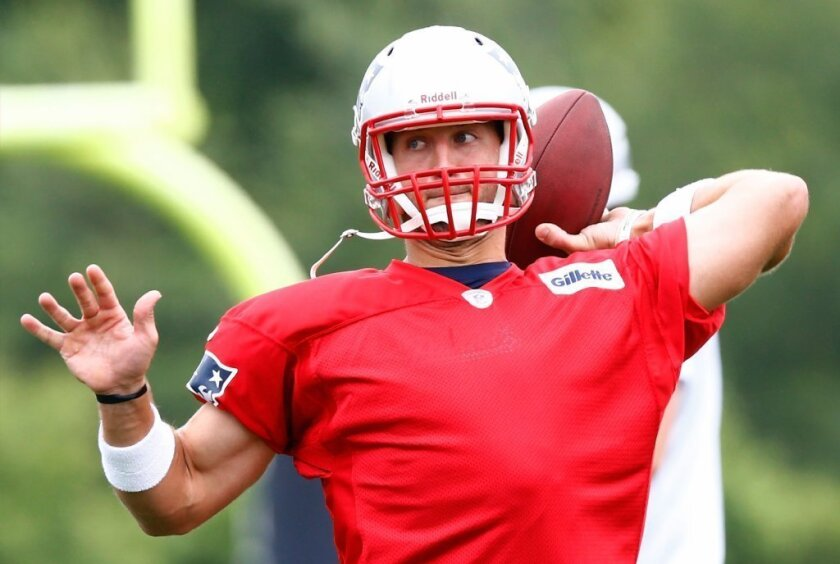 Coach says Tim Tebow's throwing motion has improved significantly