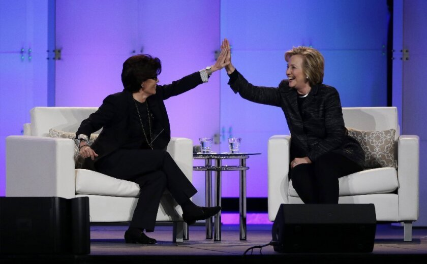 Kara Swisher, left, high-fives Hillary Rodham Clinton during the Watermark Silicon Valley Conference for Women in February. On Tuesday, Vox Media announced that it had acquired Re/Code, the tech business news site cofounded by Swisher and Walt Mossberg.