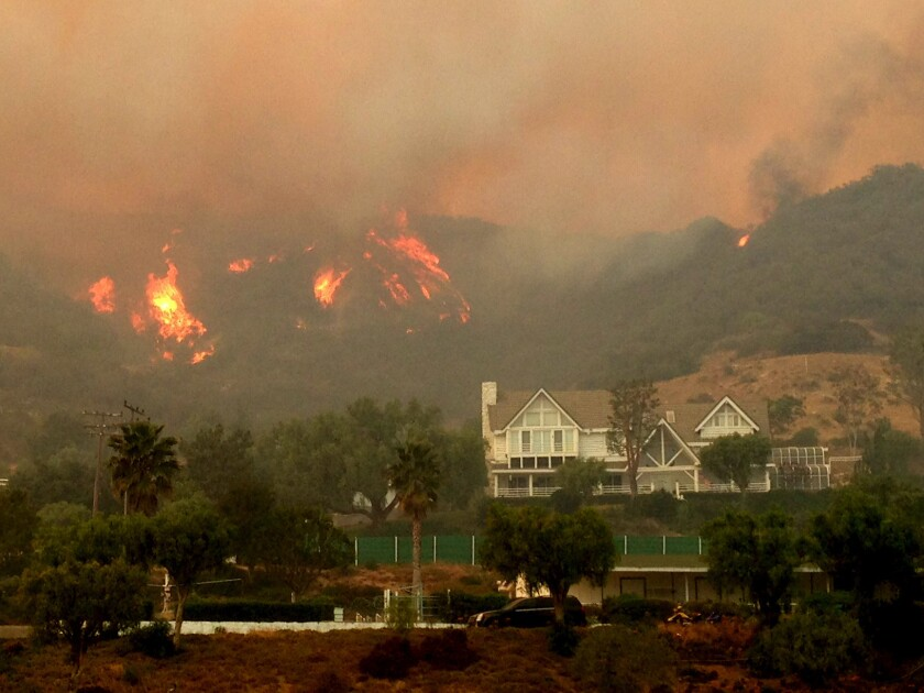 Fire comes close to homes in the hills above Hidden Valley in Thousand Oaks.