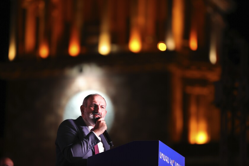 Armenian acting Prime Minister Nikol Pashinyan speaks during a rally in his support after winning snap parliamentary elections in Yerevan, Armenia, Monday, June 21, 2021. Voting results show that the party of Armenia's acting Prime Minister Nikol Pashinyan has won snap parliamentary elections which he called to ease anger over a peace deal he signed with Azerbaijan. The election commission said Pashinyan's Civil Contract party won 53.9% of the vote. Former President Robert Kocharyan's bloc was a distant second with about 21%. (Tigran Mehrabyan/PAN Photo via AP)