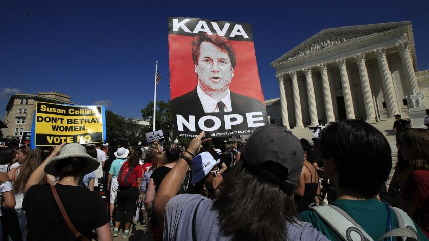Protesters against Supreme Court nominee Brett Kavanaugh demonstrate outside the Supreme Court in Wa