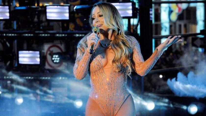 Mariah Carey performs in Times Square on New Year's Eve in New York, where controversy ensued after charges much of her singing was pre-recorded. (Photo by Stephanie Keith / Reuters)