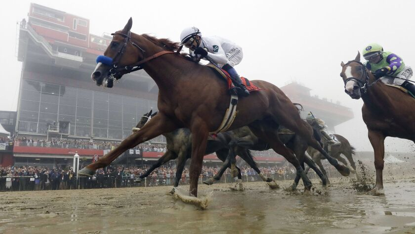 Justify, with Mike Smith aboard, wins the 143rd Preakness Stakes at Pimlico race course in Baltimore on May 19, 2018.