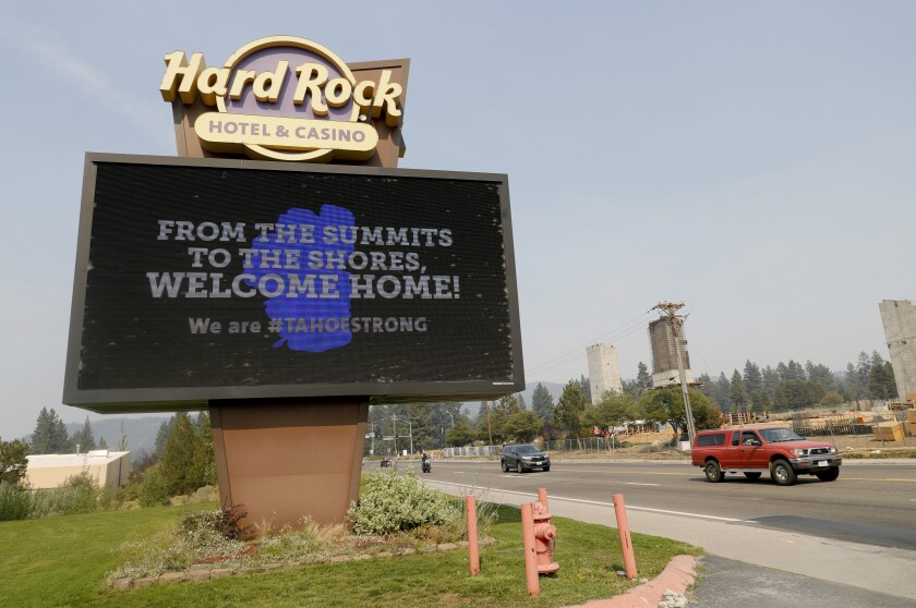 A welcome home sign is seen at the Hard Rock Hotel & Casino Highway 50 near Stateline, Nev., on Monday, Sept. 6, 2021. The hotel is being used by firefighters and other first responders working the Caldor Fire. (Jane Tyska/Bay Area News Group via AP)