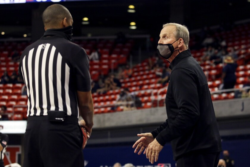 Tennessee head coach Rick Barnes talks with a referee about a call during the second half of an NCAA basketball game against Auburn Saturday, Feb. 27, 2021, in Auburn, Ala. (AP Photo/Butch Dill)