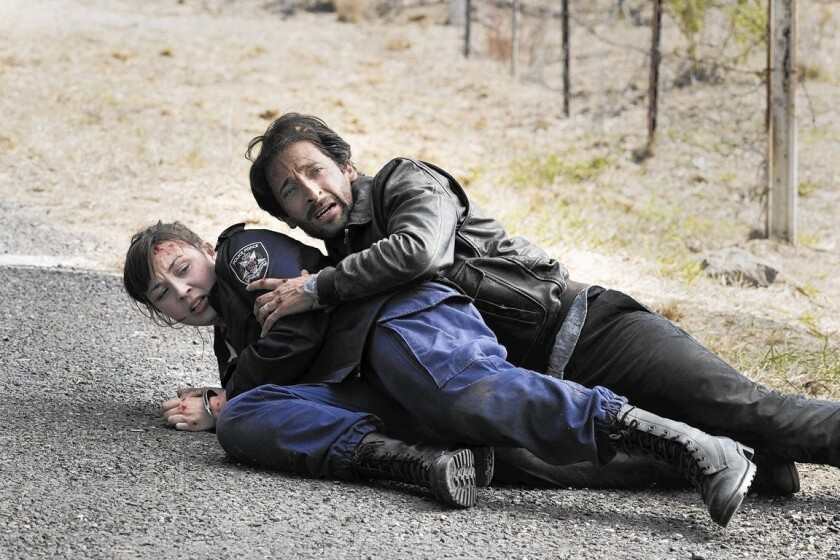 """Robin McLeavy and Adrien Brody in """"Backtrack,"""" a moody horror tale."""