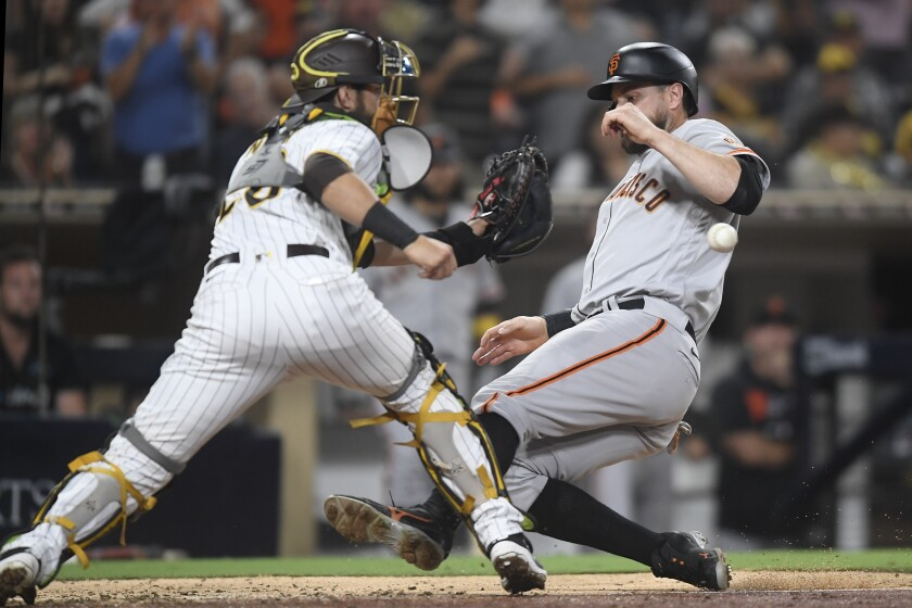Brandon Belt of the Giants scores ahead of attempted tag by Austin Nola of the Padres, who was injured on play.