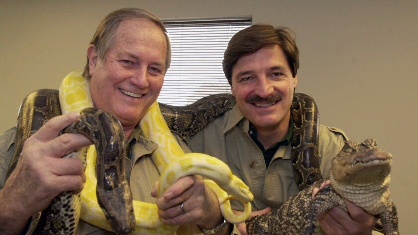 """Mutual of Omaha's Jim Fowler, left, and Peter Gros in 2002. The """"Wild Kingdom"""" host died May 8, 2019. He ws 89."""