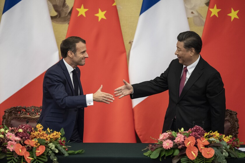 French President Emmanuel Macron, left, shakes hands with Chinese President Xi Jinping following a signing ceremony at the Great Hall of the People in Beijing, Wednesday, Nov. 6, 2019. (Nicolas Asfouri/Pool Photo via AP)