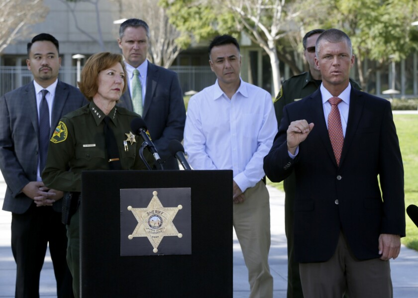Orange County Sheriff Sandra Hutchens, left, at a news conference Jan. 29 in Santa Ana, said the escape of three jail inmates was an embarrassment for her department.