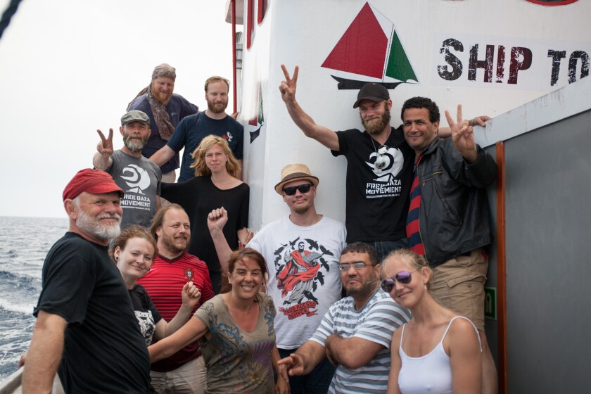 A photo shows crew members and passengers aboard the Marianne of Gothenburg, which was intercepted by Israeli forces on June 29.