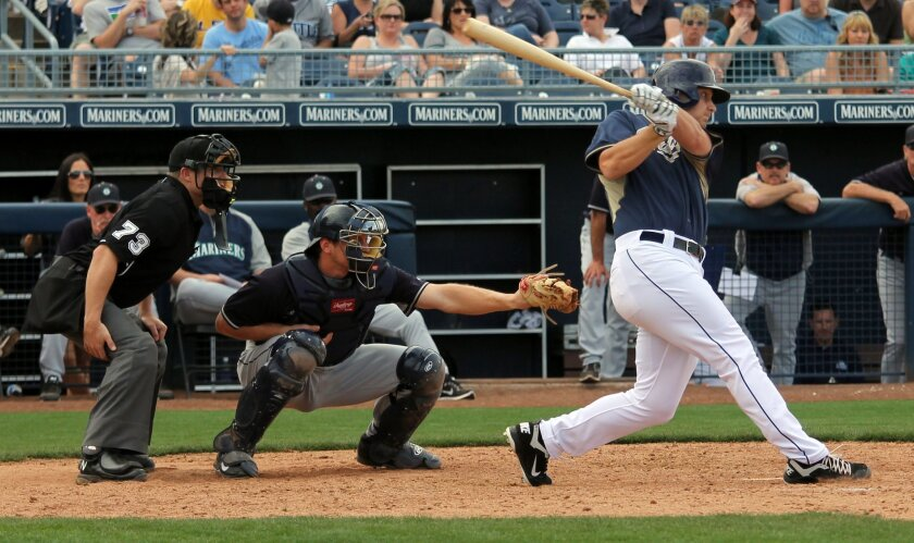 Padres outfielder Alex Dickerson takes a swing against the Mariners during their spring training game in Peoria, Ariz.