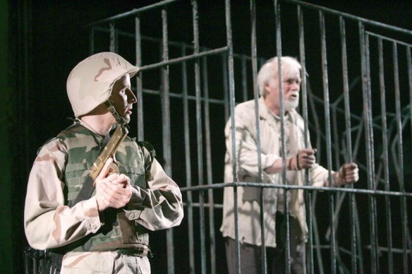 """Brad Fleishcer, left, and Kevin Tighe in Rajiv Joseph's """"Bengal Tiger at the Baghdad Zoo."""""""