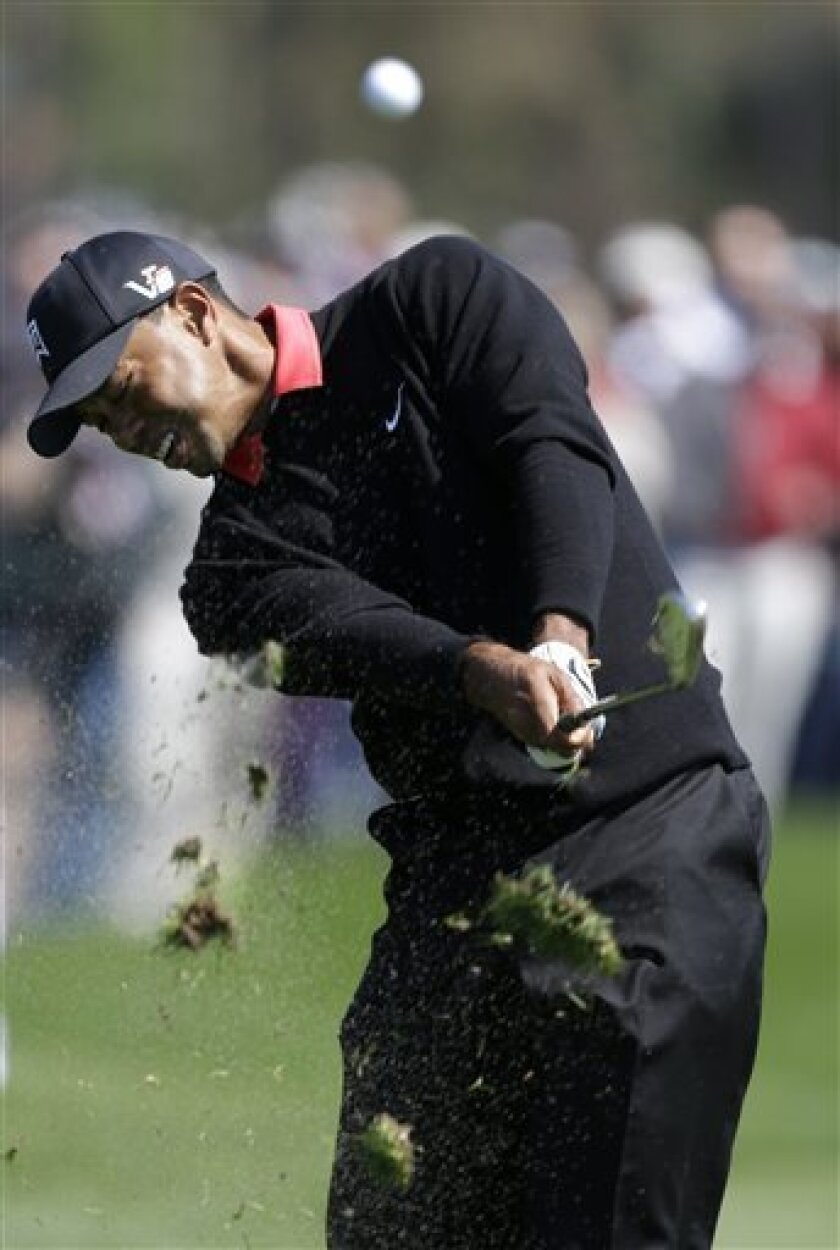Tiger Woods hits out of the fourth fairway during the final round of the Honda Classic golf tournament on Sunday, March 3, 2013 in Palm Beach Gardens, Fla. (AP Photo/Wilfredo Lee)