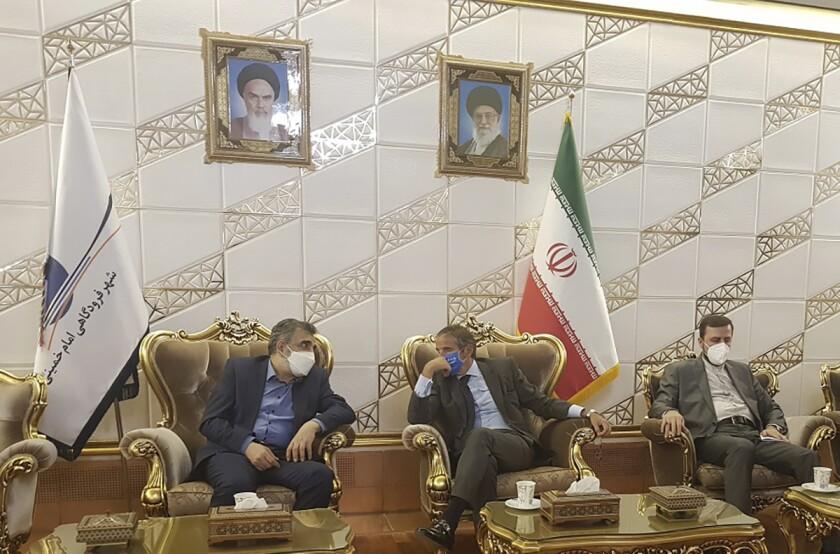 Rafael Grossi, center, and Behrouz Kamalvandi speak in Tehran on Saturday.