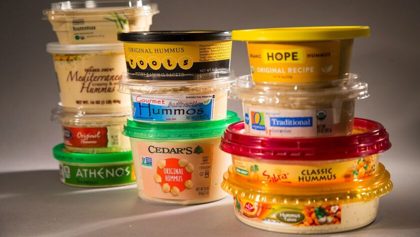 A variety of store-bought hummus brands are a part of a blind taste test.