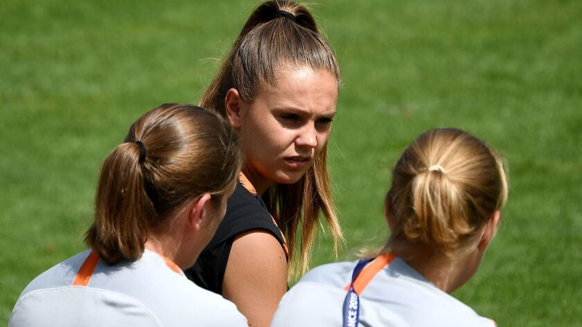 Netherlands forward Lieke Martens speaks with teammates during a training session July 2 outside Lyon, France.