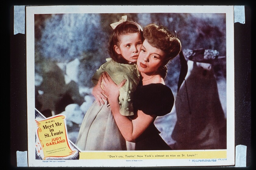 "Judy Garland hugs Margaret O'Brien in an MGM photo for ""Meet Me in St. Louis,"" whose 75th anniversary is being marked with screenings in theaters."
