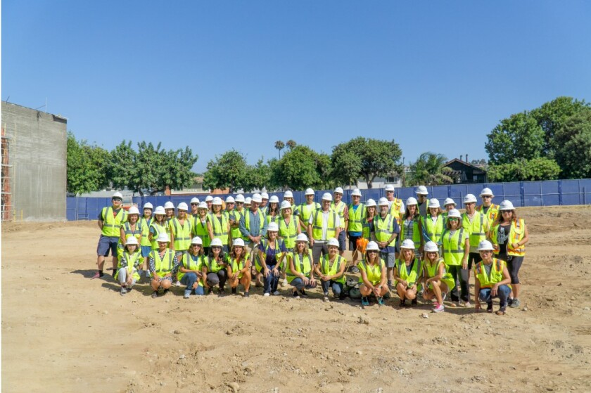PB Middle School's teachers and staff on the site of the future two-story, 26-classroom building, to be completed next year. It will replace the old administrative and classroom buildings, built in the early 1950s.