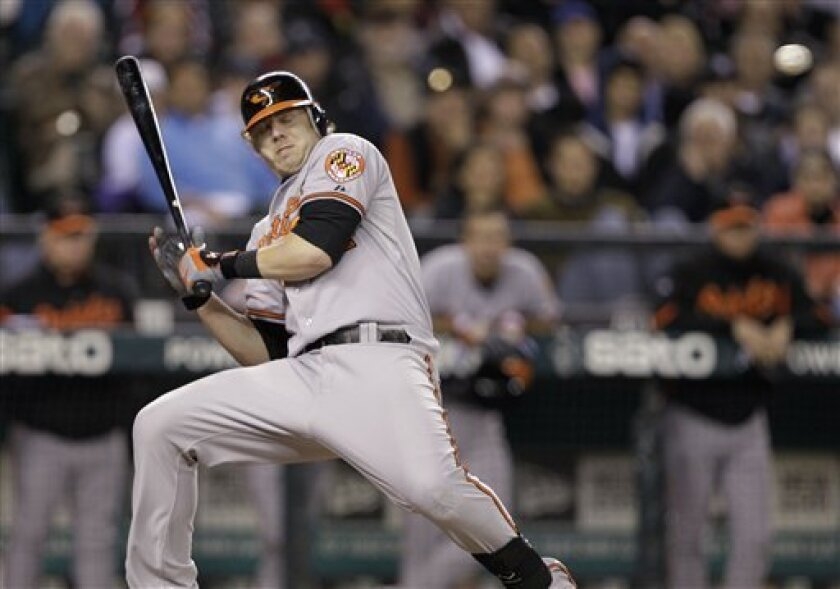 Baltimore Orioles' Mark Reynolds begins to fall backwards on an inside pitch that sent him sprawling against the Seattle Mariners in the ninth inning of a baseball game Tuesday, May 31, 2011, in Seattle. The Mariners won 3-2. (AP Photo/Elaine Thompson)
