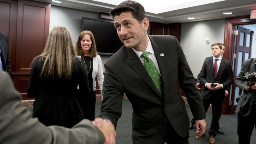 House Speaker Paul D. Ryan (R-Wis.) shakes hands following a roundtable on tax reform on Capitol Hill on April 17.