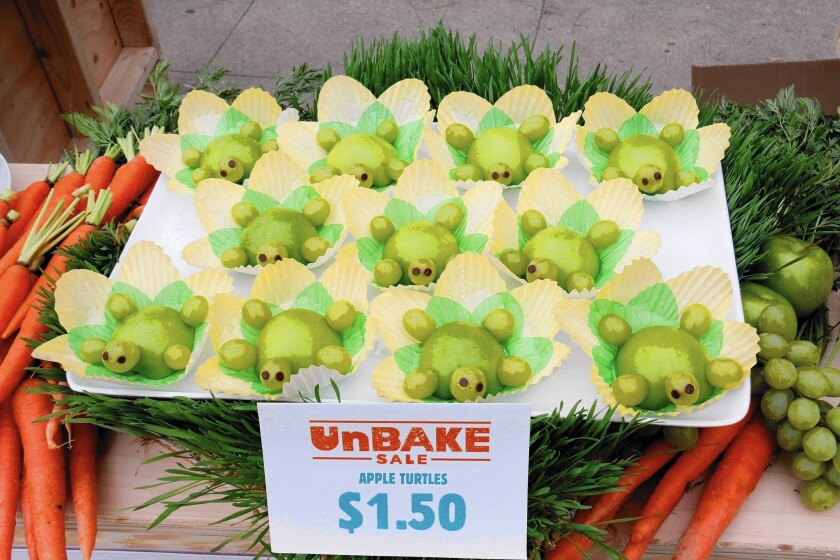 """Some of the creative, healthful snacks at the UnBake Sale demonstration at Marquez Elementary in Pacific Palisades. The """"turtles"""" are made with half a Granny Smith apple and green grapes."""