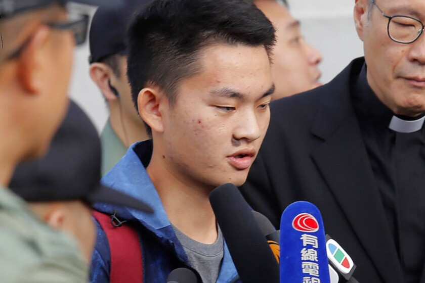 Suspect Chan Tong-kai fields questions after being released from prison Wednesday.