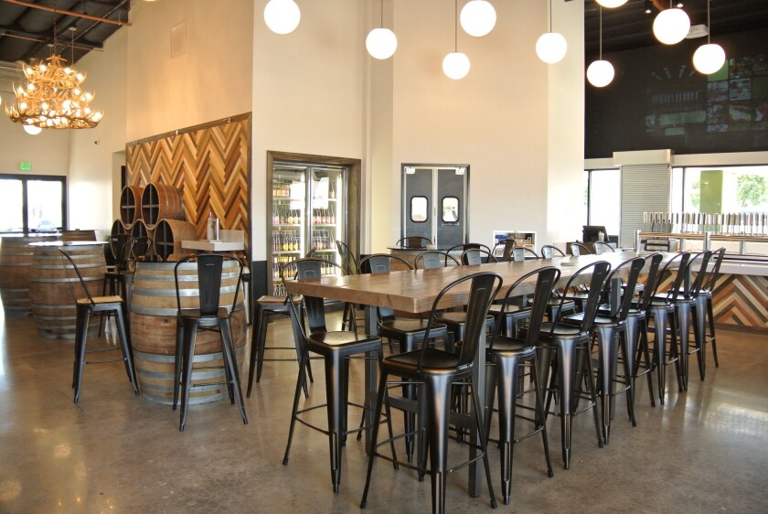 The new tasting room at the Bruery Terreux, which features a herringbone arrangement of reclaimed wood along one wall.