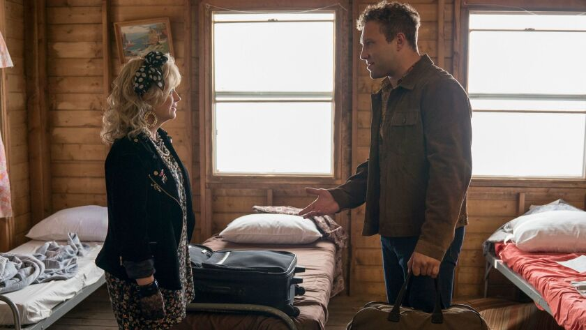 Amy Poehler is a former camp counselor and Jai Courtney the star of the movie she's producing in Net