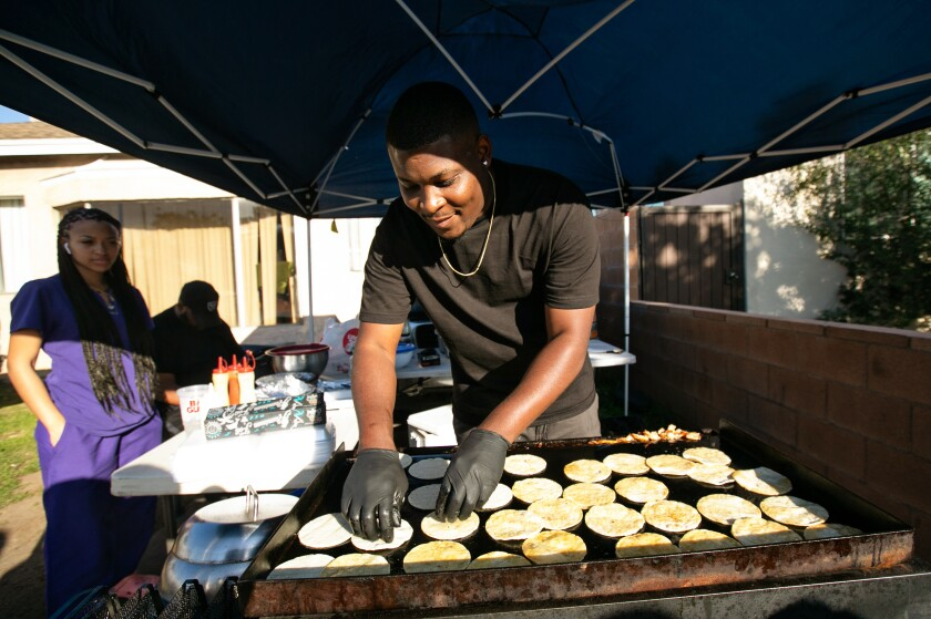 Deon Steward, chef and owner of Munchie Madness in Compton, prepares food for his customers. Steward is among a wave of food entrepreneurs who are using social media like Instagram and Twitter to connect with hungry followers.