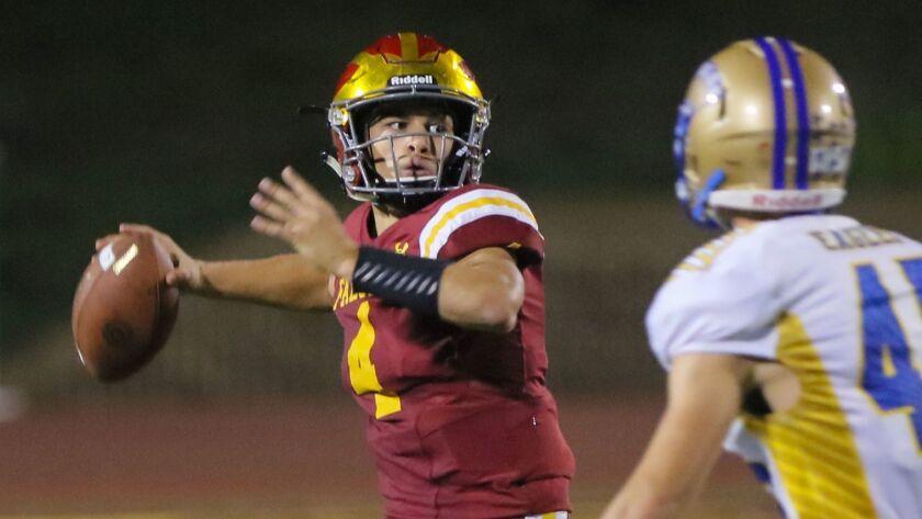 San Pasqual at Torrey Pines- Torrey Pines quarterback Jason Heine looks for an open receiver. Defending for San Pasqual is Sam Bandick.