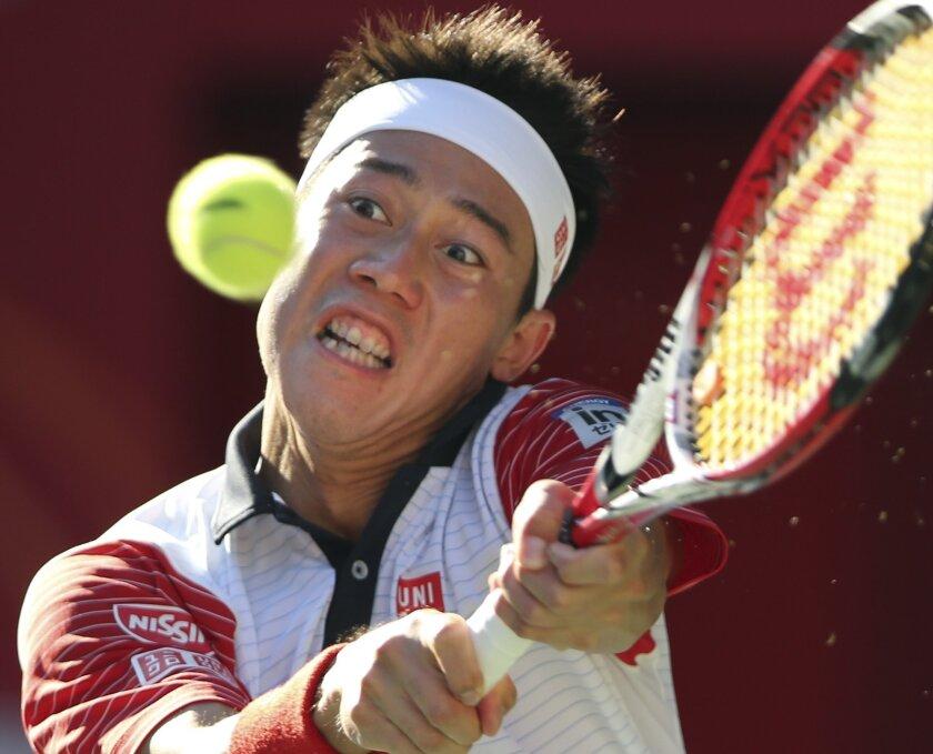 Kei Nishikori of Japan returns a shot against Jeremy Chardy of France during their quarter-final match of Japan Open Tennis Championships in Tokyo, Friday, Oct. 3, 2014. (AP Photo/Koji Sasahara)