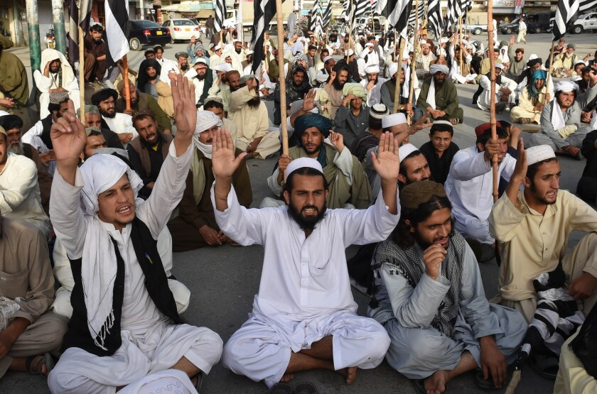 Pakistani members of the Jamiat Nazriati party pay tribute to Afghanistan's deceased Taliban chief Mullah Mohammed Omar, in Quetta, Pakistan, on Sunday.