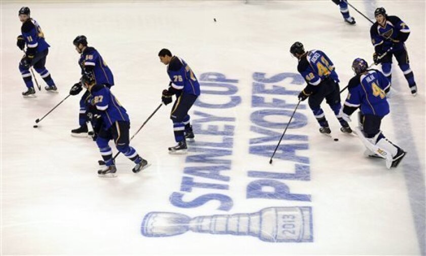 St. Louis Blues players warm up before Game 1 of their first-round NHL hockey Stanley Cup playoff series against the Los Angeles Kings, Tuesday, April 30, 2013, in St. Louis. (AP Photo/Bill Boyce)