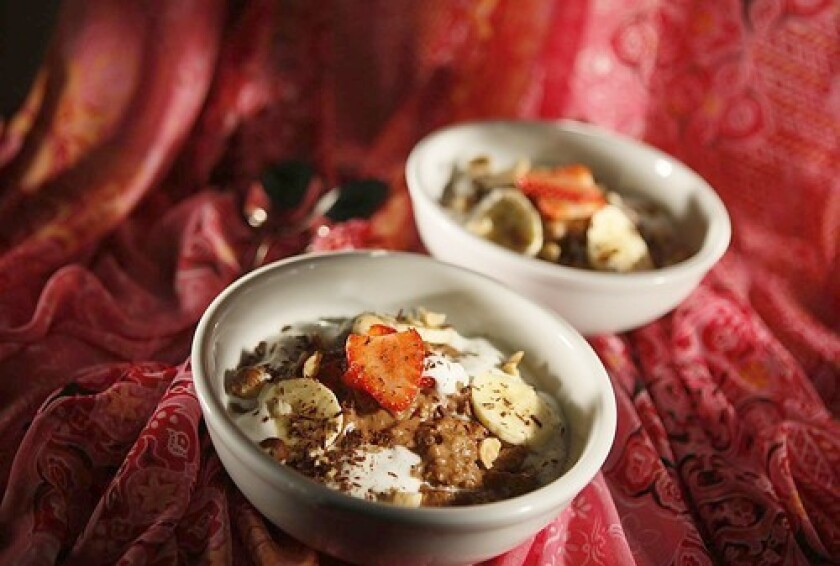 START THE DAY RIGHT: Hazelnut-chocolate oatmeal with strawberries and cream.