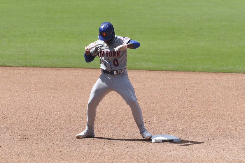 New York Mets' Marcus Stroman dances at second base after hitting a RBI double off San Diego Padres relief pitcher Craig Stammen in the seventh inning of a baseball game Sunday, June 6, 2021, in San Diego. Jose Peraza scored on the play. (AP Photo/Derrick Tuskan)