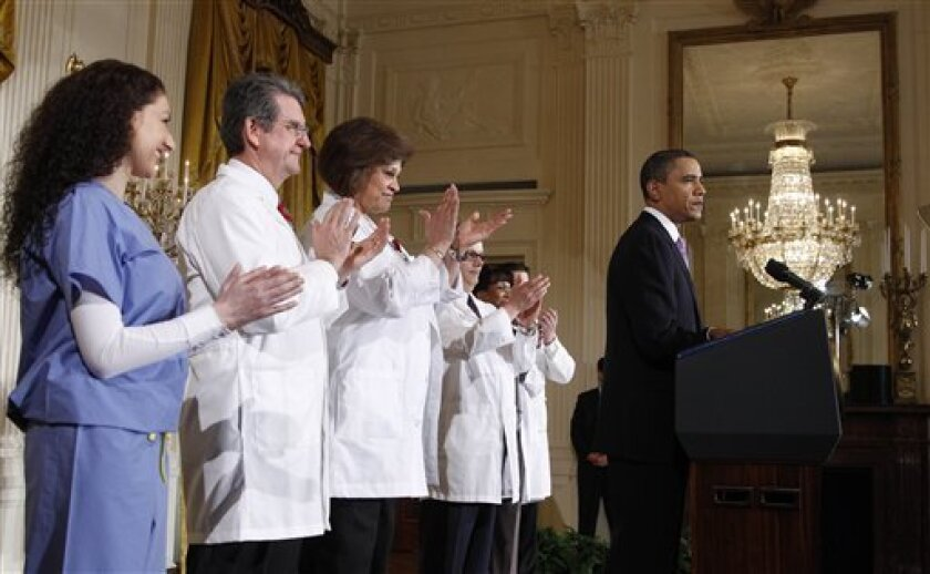 As President Barack Obama pauses while speaking about health care reform, Wednesday, March 3, 2010, in the East Room of the White House in Washington. Applauding, from left are, Julie Babich, Dr. Roland Goertz, Barbara Crane, Stephen Hanson, Dr. Renee Jenkins, Christopher Lillis. (AP Photo/Alex Brandon)