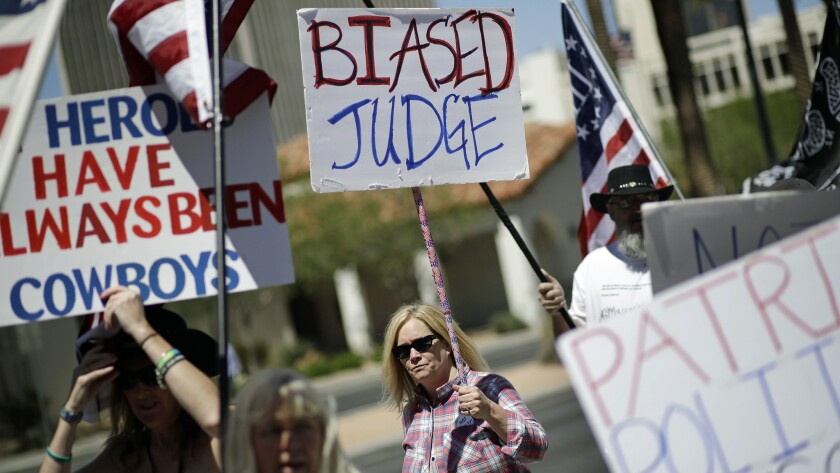 Demonstrators show their support for six men on trial in Las Vegas who are accused of wielding weapons to stop federal agents.
