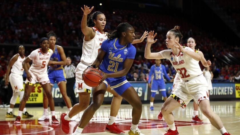 UCLA forward Michaela Onyenwere protects the ball as she is pressured by Maryland guard Sara Vujacic, right, and forward Stephanie Jones.